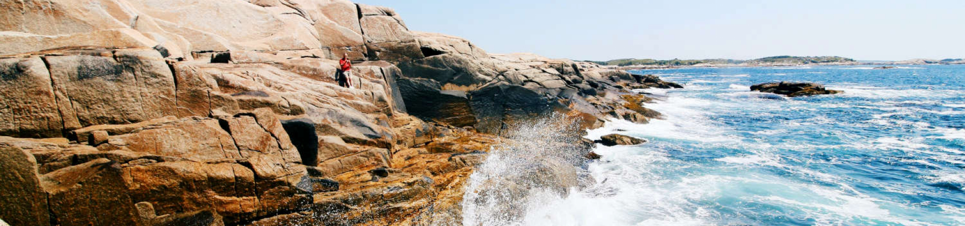 Waves crashing on coastal rocks in Nova Scotia